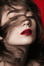 Female model with ruffled hair portrait of glamour dreamy or ecstatic expression and or blowing in the wind part red Stock Photo