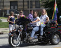 Female motorcycle riders with rainbow flag at indy pride parade in indianapolis indiana Royalty Free Stock Photo