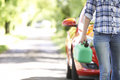 Female Motorist Carrying Fuel Can Next To Broken Down Car Royalty Free Stock Photo