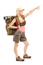 Female mountaineer pointing with hand full length portrait of a isolated on white background Royalty Free Stock Photo