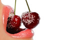 Female mouth with red cherries Royalty Free Stock Photos