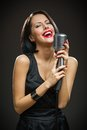 Female musician with closed eyes keeping mic half length portrait of wearing black evening dress and on grey background concept of Stock Photos