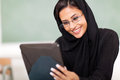 Female muslim college student using tablet computer classroom Stock Photography