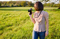 Female nature photographer a beautiful young woman out in taking photos Stock Images