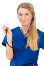 Female nurse or doctor showing stethoscope portrait of a happy young medical close up isolated on white background Royalty Free Stock Photo