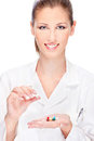 Female nurse holding medics pretty medicals isolated on white Stock Photography