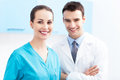 Female nurse and male doctor friendly doctors Royalty Free Stock Image