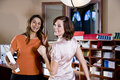 Female office workers chatting in copy room Royalty Free Stock Photo