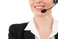 Female operator cropped image of confident mature customer service representative in headset smiling while isolated on white Royalty Free Stock Photos