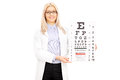 Female optician holding eyesight test isolated on white background Stock Image