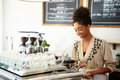 Female owner of coffee shop making Stock Photos