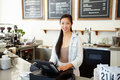 Female owner of coffee shop smiling to camera Royalty Free Stock Photography