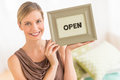 Female owner holding framed open sign in bedding store portrait of beautiful Stock Images