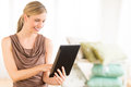 Female owner using digital tablet in bedding store beautiful Stock Photo