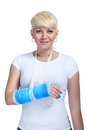Female patient with broken arm in cast on a white background Stock Photo