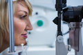 Female patient under going eye test on slit lamp Royalty Free Stock Photo