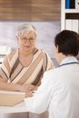 Female pensioner at doctors office Royalty Free Stock Image