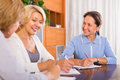 Female pensioners making list and smiling indoor focus on brunette Stock Images