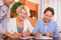 Female pensioners with public notary happy smiling signing documents Stock Images