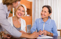 Female pensioners with public notary two positive signing documents Stock Images