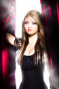 Female performer behind the stage curtain light Royalty Free Stock Photography