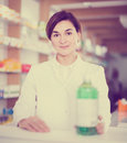 Female pharmacist demonstrating assortment of pharmacy