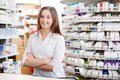 Female pharmacist smiling portrait of standing with arms crossed at counter in pharmacy Royalty Free Stock Photos