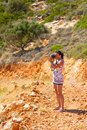 Female photographer in Greek scenery Stock Image