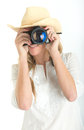Female photographer with hat taking a picture beautiful shooting camera Royalty Free Stock Photo