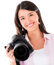Female photographer holding a digital camera isolated over white Royalty Free Stock Images