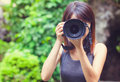 Female photographer at the park Royalty Free Stock Image