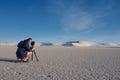 Female photographer taking landscape photo of sand dunes Royalty Free Stock Photo