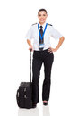 Female pilot briefcase beautiful woman airline with standing on white background Royalty Free Stock Images