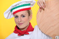 Female pizza chef in her uniform Royalty Free Stock Photo