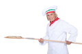 Female pizza chef with a wooden peel Royalty Free Stock Images