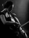 Female playing the cello black and white photo of a beautiful musician a backlit image Royalty Free Stock Photography