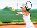Female playing tennis waiting ball Royalty Free Stock Photo