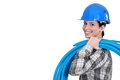 Female plumber carrying pipes Royalty Free Stock Photos