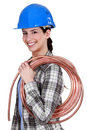 Female plumber holding pipe Stock Images