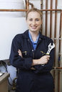 Female Plumber Working On Central Heating Boiler Royalty Free Stock Photo