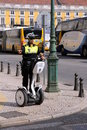 Female police officer on a segway in the city of lisbon portugal in the year Stock Images