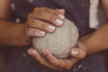 Female potter hands holds clay for pottery, selective focus Royalty Free Stock Photo