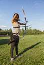 Female Practicing Archery Royalty Free Stock Photo
