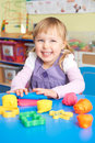 Female Pre School Pupil Playing With Modelling Clay Royalty Free Stock Photo