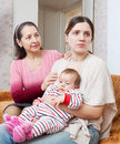 Female problems mature mother asks for forgiveness from daught family adult daughter with baby after quarrel at home Stock Images