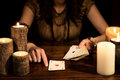 Female psychic is telling the future with cards concept tarot a playing and numerology Stock Image