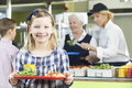 Female pupil with healthy lunch in school canteen portrait of Royalty Free Stock Photos