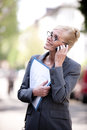 Female Real Estate Agent talking on phone Royalty Free Stock Photo