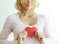 Female with red heart close up of pretty paper Royalty Free Stock Image