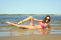 Female relaxing on the beach at summer day young Royalty Free Stock Image